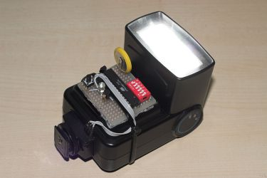 Power controlling slave flash trigger